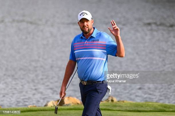 Marc Leishman of Australia smiles and waves to fans on the 18th hole during the final round of the Arnold Palmer Invitational presented by MasterCard...