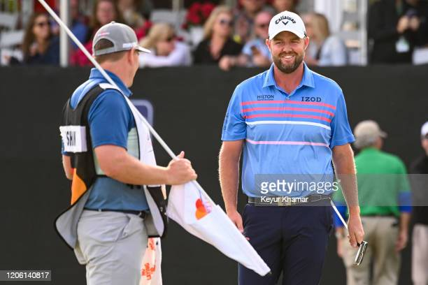 Marc Leishman of Australia smiles on the 17th hole green during the final round of the Arnold Palmer Invitational presented by MasterCard at Bay Hill...