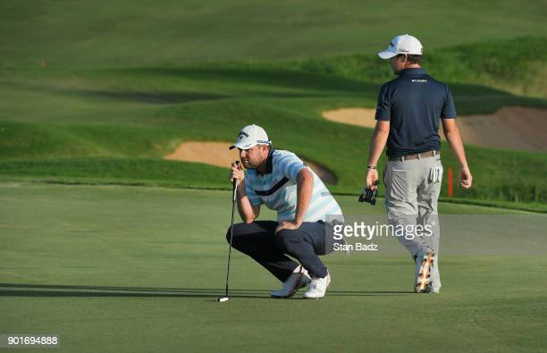 Marc Leishman of Australia studies his putt on the 18th green during the second round of the Sentry Tournament of Champions at Plantation Course at...