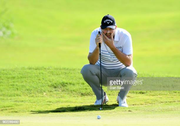Marc Leishman of Australia studies his putt on the seventh hole during the third round of the Sentry Tournament of Champions at Plantation Course at...