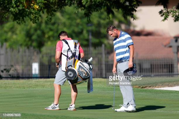 Marc Leishman of Australia takes part in a moment of silence in place of the 8:46 tee time to honor George Floyd during the first round of the...