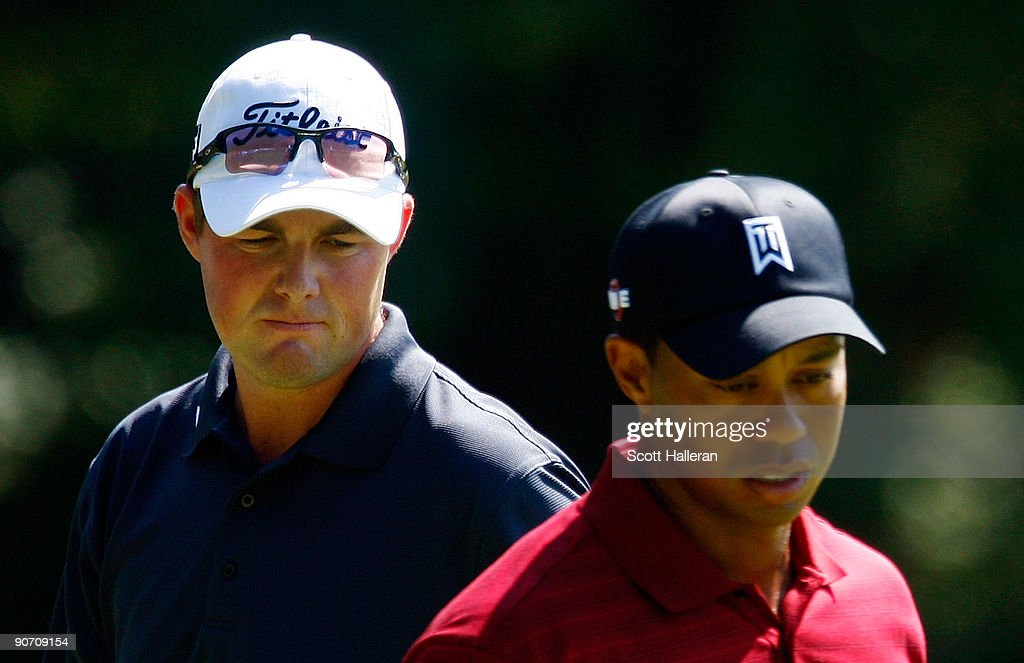 Marc Leishman of Australia waits alongside Tiger Woods on the sixth green during the final round of the BMW Championship held at Cog Hill Golf & CC on September 13, 2009 in Lemont, Illinois.