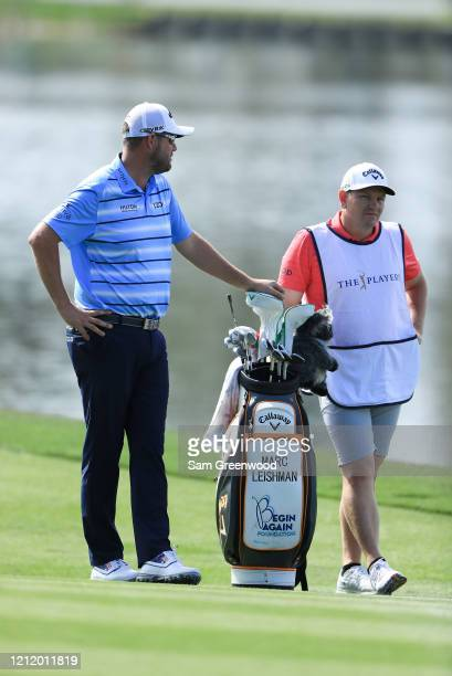 Marc Leishman of Australia waits in the 18th fairway during the first round of The PLAYERS Championship on The Stadium Course at TPC Sawgrass on...