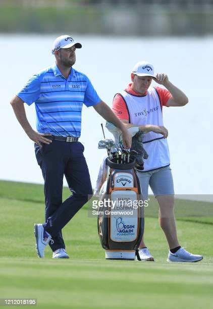 Marc Leishman of Australia waits to play a shot in the 18th fairway during the first round of The PLAYERS Championship on The Stadium Course at TPC...