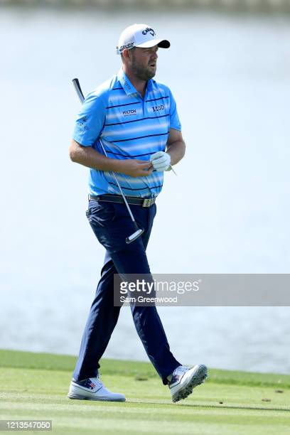 Marc Leishman of Australia walks down the 18th hole during the first round of The PLAYERS at the TPC Stadium course on March 12 2020 in Ponte Vedra...