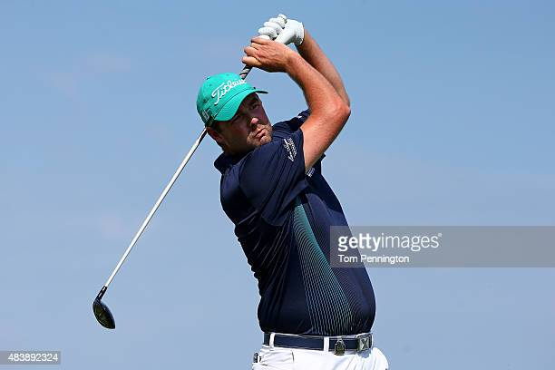 Marc Leishman of Australia watches a tee shot during the first round of the 2015 PGA Championship at Whistling Straits on August 13 2015 in Sheboygan...