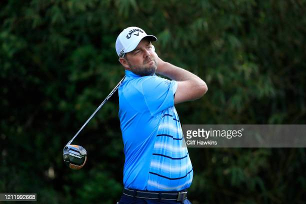 Marc Leishman of Australia watches his drive on the 11th hole during the first round of The PLAYERS Championship on The Stadium Course at TPC...
