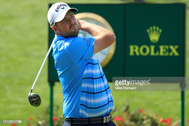 Marc Leishman of Australia watches his tee shot on the 18th hole during the first round of The PLAYERS Championship on The Stadium Course at TPC...