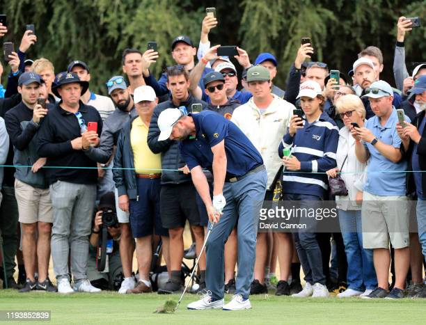 Marc Leishman of the International Team plays his second shot on the 18th hole in his match with Abraham Ancer in their match against Rickie Fowler...