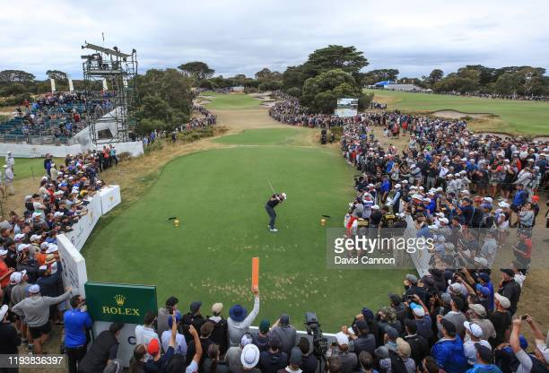 Marc Leishman of the International Team plays his tee shot on the par 3 third hole in his match with Abraham Ancer in their match against Rickie...