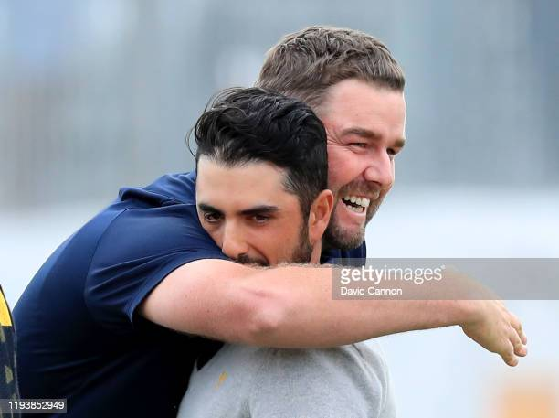 Marc Leishman of the International Team reacts with Abraham Ancer after they had tied their match on the 18th hole against Rickie Fowler and Justin...
