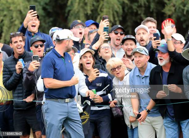 Marc Leishman of the International Team reacts with the crowds to his second shot on the 18th hole in his match with Abraham Ancer in their match...
