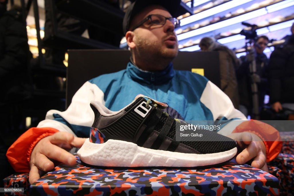 best website a21d5 ec584 Marc Leuschner, head of the Overkill sneaker store, holds ...
