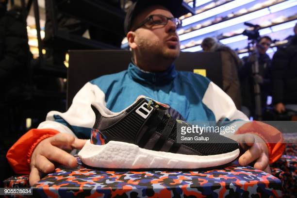 Marc Leuschner head of the Overkill sneaker store holds the very limited edition adidas EQT Support 93/Berlin shoe as he speaks to the media shortly...