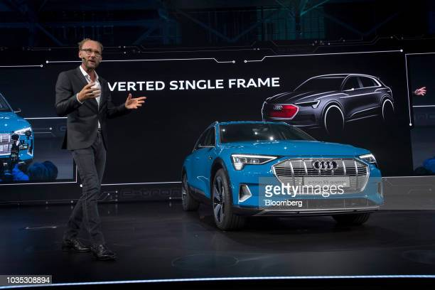 Marc Lichte head of design at Audi AG speaks while standing next to the new Audi AG ETron allelectric sport utility vehicle during a launch event in...