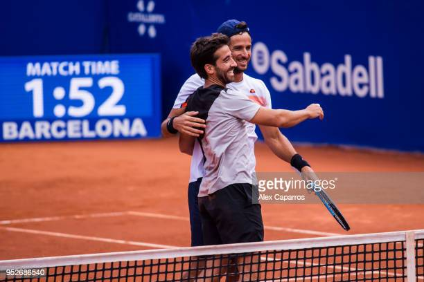 Marc Lopez and Feliciano Lopez of Spain celebrate their victory against AisamUlHaq Qureshi of Pakistan and JeanJulien Rojer of The Netherlands in...
