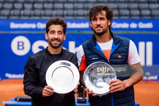 Marc Lopez and Feliciano Lopez of Spain pose with their trophies after their victory against AisamUlHaq Qureshi of Pakistan and JeanJulien Rojer of...