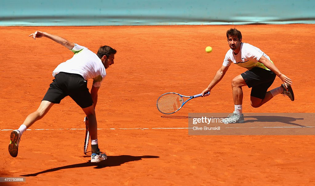 Marc Lopez and Marcel Granollers of Spain in action against Rohan Bopanna of India and Florin Mergea of Romania in their doubles semi final match during day eight of the Mutua Madrid Open tennis tournament at the Caja Magica on May 9, 2015 in Madrid, Spain.