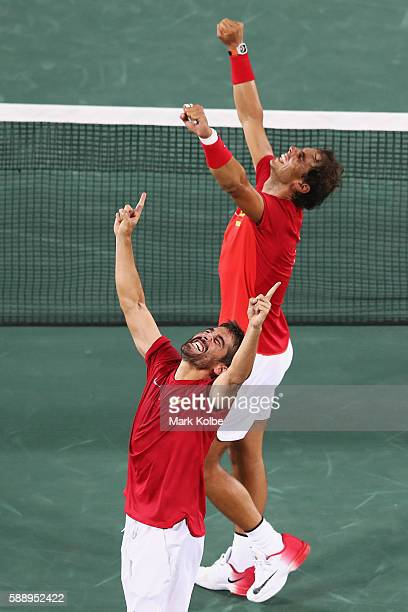 Marc Lopez and Rafael Nadal of Spain celebrate match point during the Men's Doubles Gold medal match against Horia Tecau and Florin Mergea of Romania...