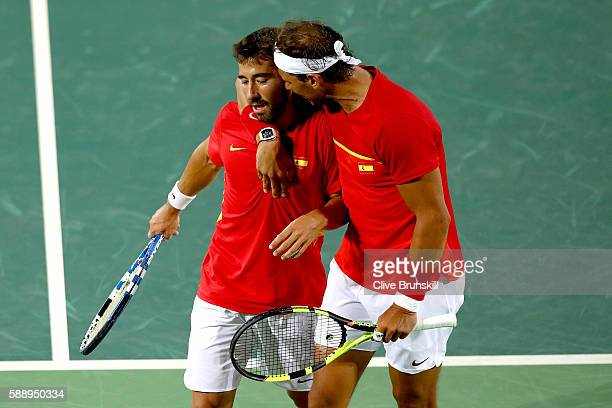Marc Lopez and Rafael Nadal of Spain confer during the Men's Doubles Gold medal match against Horia Tecau and Florin Mergea of Romania on Day 7 of...