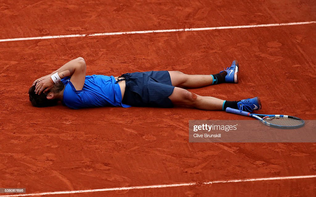 Marc Lopez of Spain celebrates victory during the Men's Doubles final match against Mike Bryan and Bob Bryan of the United States on day fourteen of the 2016 French Open at Roland Garros on June 4, 2016 in Paris, France.