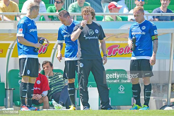 Marc Lorenz, Christian Mueller, head coach Stefan Kraemer and Thomas Huebener of Bielefeld stand dejected beside the pitch during the Second...