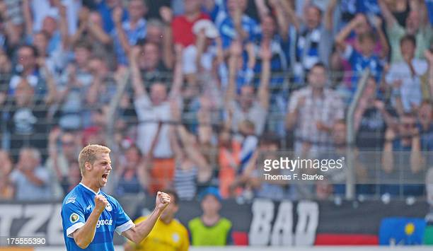 Marc Lorenz of Bielefeld celebrates after winning the DFB Cup first round match between Arminia Bielefeld and Eintracht Braunschweig at the Schueco...