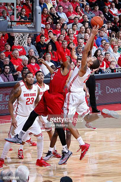 Marc Loving of the Ohio State Buckeyes rebounds over Chris Bryant of the Miami Redhawks during the game at Value City Arena on December 22 2014 in...