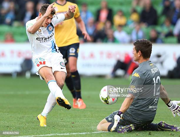 Marc Marino of Melbourne City misses a kick for goal as Liam Reddy of Central Coast Mariners makes a save during the round six ALeague match between...