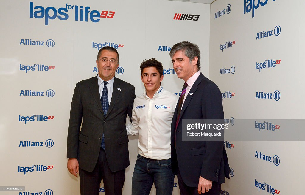Marc Marquez (C) attends a photocall for Allianz Seguros at Torre Allianz on April 22, 2015 in Barcelona, Spain.