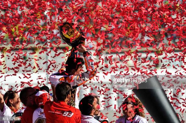 Marc Marquez celebrate the world championship on podium at Valencia Motogp.