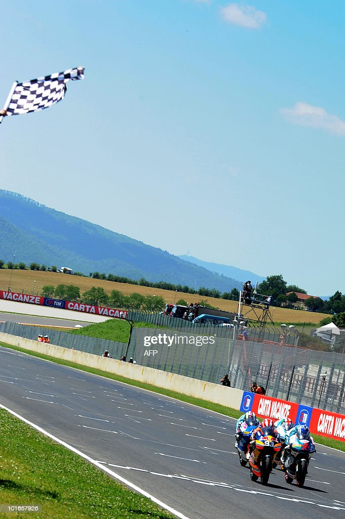 Marc Marquez (1st L) of Red Bull AJo Motorsport Team crosses the finish line ahead of Nico Terol of Bancaja Aspar Team and Pol Espargaro of Tuenti Racing Team of Spain in the 125 cc race of the Italian Grand Prix at Mugello on June 6, 2010.