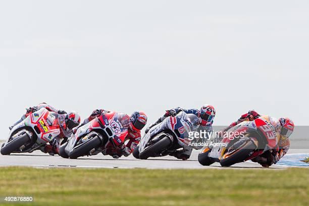 Marc Marquez of Repsol Honda Team followed by Hector Barbera of Avintia Racing Andrea Dovizioso of Ducati Team and Hector Barbera of Avintia Racing...