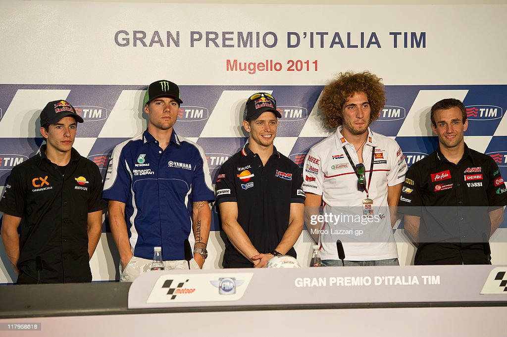 Marc Marquez of Spain and Catalunya Caixa Repsol, Ben Spies of USA and Yamaha Factory Racing, Casey Stoner of Australia and Repsol Honda Team, Marco Simoncelli of Italy and San Carlo Honda Gresini pose during the press conference at the end of the qualifying practice of the MotoGP of Italy at Mugello Circuit on July 2, 2011 in Scarperia near Florence, Italy.