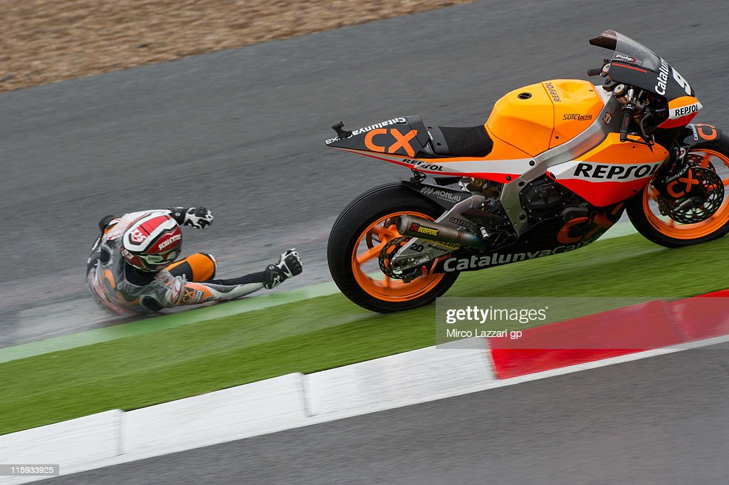Marc Marquez of Spain and Catalunya Caixa Repsol crashes out during the warm-up of Moto2 of MotoGp Of Great Britain at Silverstone Circuit on June 12, 2011 in Northampton, England.