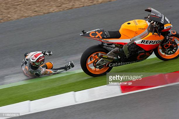 Marc Marquez of Spain and Catalunya Caixa Repsol crashes out during the warmup of Moto2 of MotoGp Of Great Britain at Silverstone Circuit on June 12...