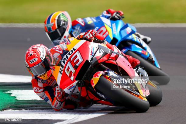 Marc Marquez of Spain and Repsol Honda leads Alex Rins of Spain and Team Suzuki Ecstar during the MotoGP of Great Britain at Silverstone Circuit on...