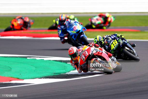 Marc Marquez of Spain and Repsol Honda leads Valentino Rossi of Italy and Monster Energy Yamaha MotoGP and Alex Rins of Spain and Team Suzuki Ecstar...