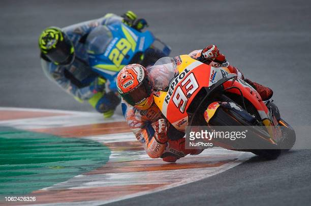 Marc Marquez of Spain and Repsol Honda Team and Andrea Iannone of Italy and Team Suzuki Ecstar during the free practice during the Gran Premio Motul...