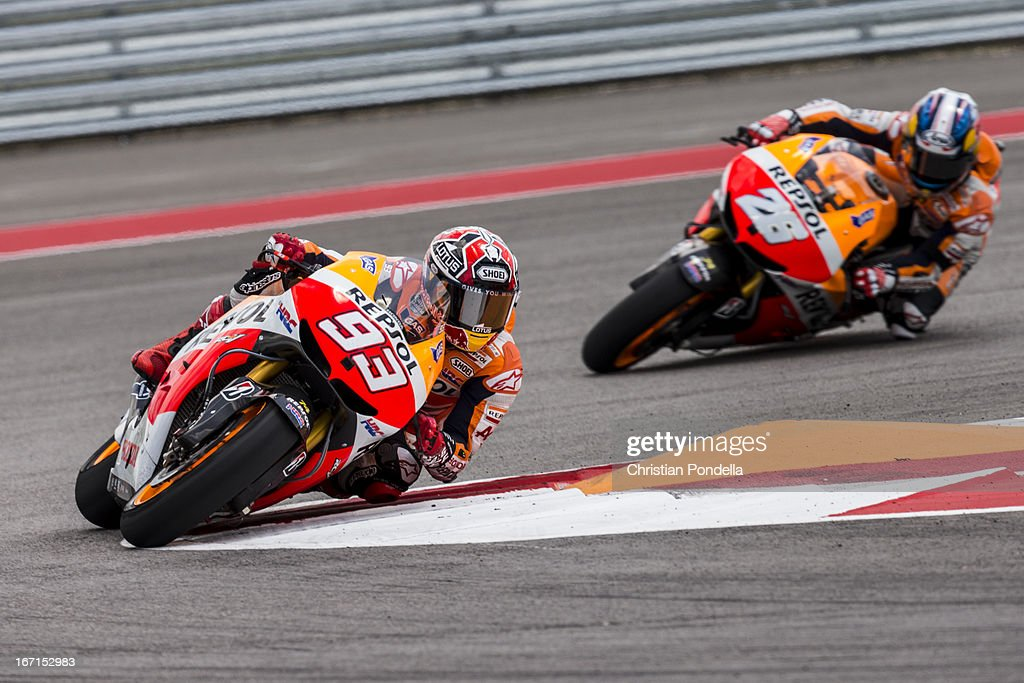 Marc Marquez of Spain and Repsol Honda Team and Dani Pedrosa of Spain and Repsol Honda Team rounds the bend during the MotoGP Red Bull U.S. Grand Prix of The Americas - Race at Circuit of The Americas on April 21, 2013 in Austin, Texas.