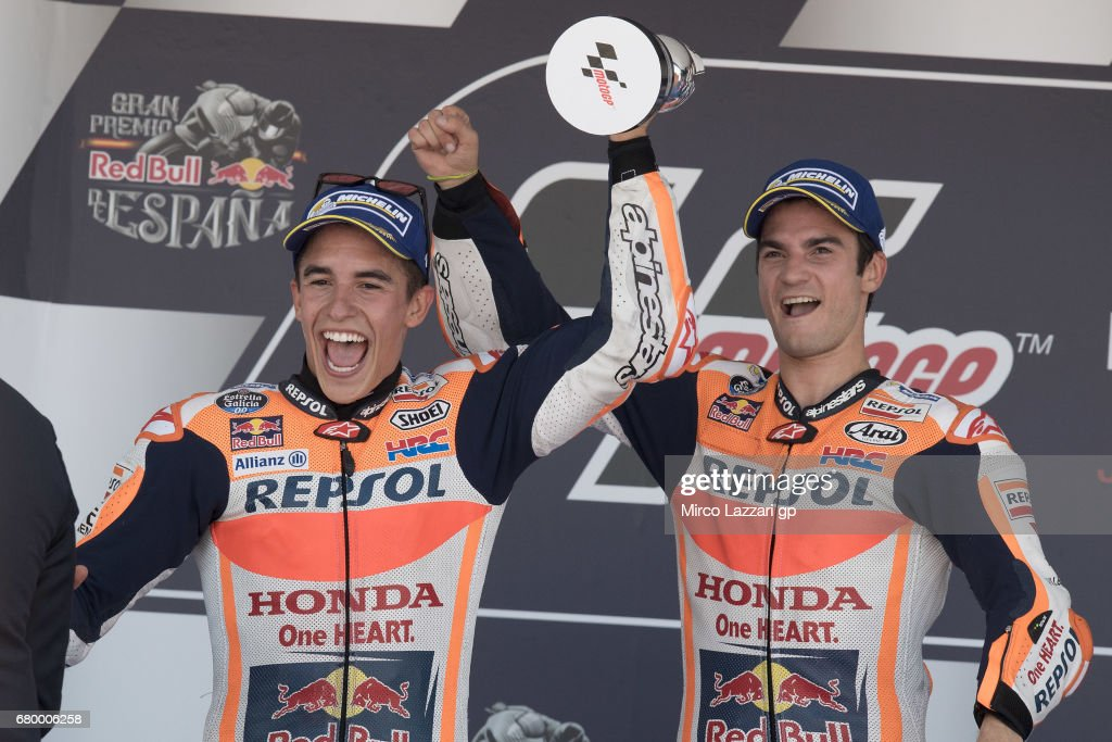 Marc Marquez of Spain and Repsol Honda Team and Dani Pedrosa of Spain and Repsol Honda Team (R) celebrate on the podium at the end of the MotoGP race during the MotoGp of Spain - Race at Circuito de Jerez on May 7, 2017 in Jerez de la Frontera, Spain.