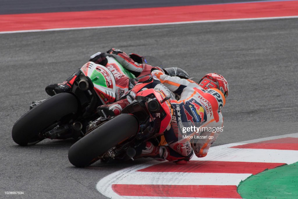 Marc Marquez of Spain and Repsol Honda Team and Scott Redding of Great Britain and Aprilia Racing Team Gresini (R) round the bend during the MotoGP of San Marino - Free Practice at Misano World Circuit on September 7, 2018 in Misano Adriatico, Italy.