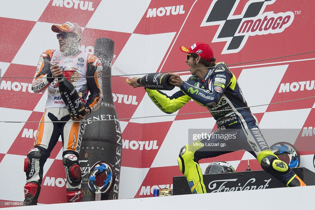 Marc Marquez of Spain and Repsol Honda Team and Valentino Rossi of Italy and Movistar Yamaha MotoGP celebrate on the podium at the end of the MotoGP race during the MotoGP Of Japan - Race at Twin Ring Motegi on October 12, 2014 in Motegi, Japan.
