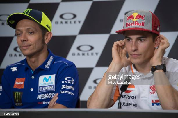 Marc Marquez of Spain and Repsol Honda Team and Valentino Rossi of Italy and Movistar Yamaha MotoGP look on during the press conference preevent...