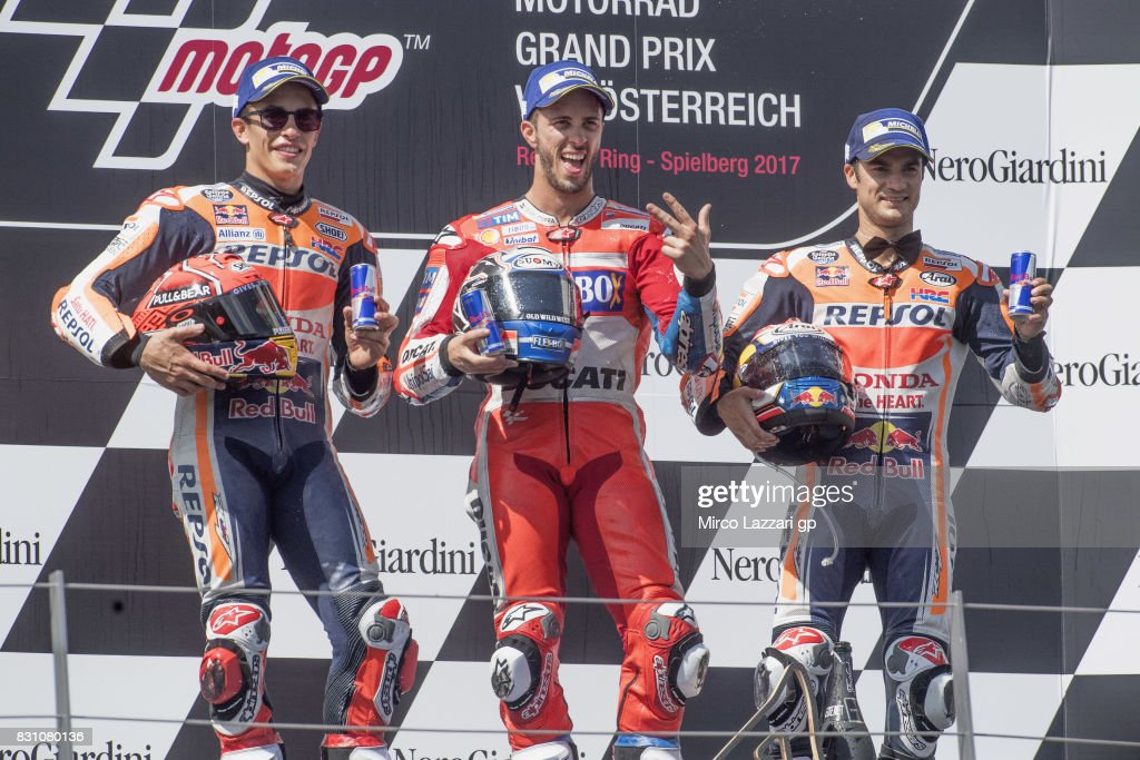 Marc Marquez of Spain and Repsol Honda Team, Andrea Dovizioso of Italy and Ducati Team and Dani Pedrosa of Spain and Repsol Honda Team pose on the podium at the end of the MotoGP race during the MotoGp of Austria - Race at Red Bull Ring on August 13, 2017 in Spielberg, Austria.