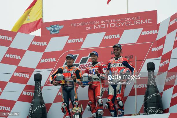 Marc Marquez of Spain and Repsol Honda Team Andrea Dovizioso of Italy and Ducati Team and celebrate on the podium at the end of the MotoGP race...