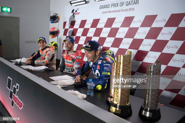 Marc Marquez of Spain and Repsol Honda Team Andrea Dovizioso of Italy and Ducati Team and look on during the press conference at the end of the...