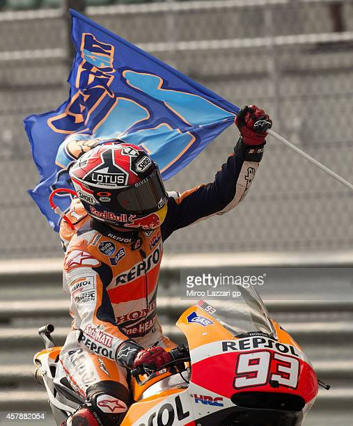 Marc Marquez of Spain and Repsol Honda Team celebrates after winning the MotoGP Of Malaysia - Race at Sepang Circuit on October 26, 2014 in Kuala...