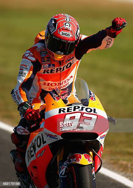 Marc Marquez of Spain and Repsol Honda Team celebrates as he returns to pit lane after winning the 2015 MotoGP of Australia at Phillip Island Grand...