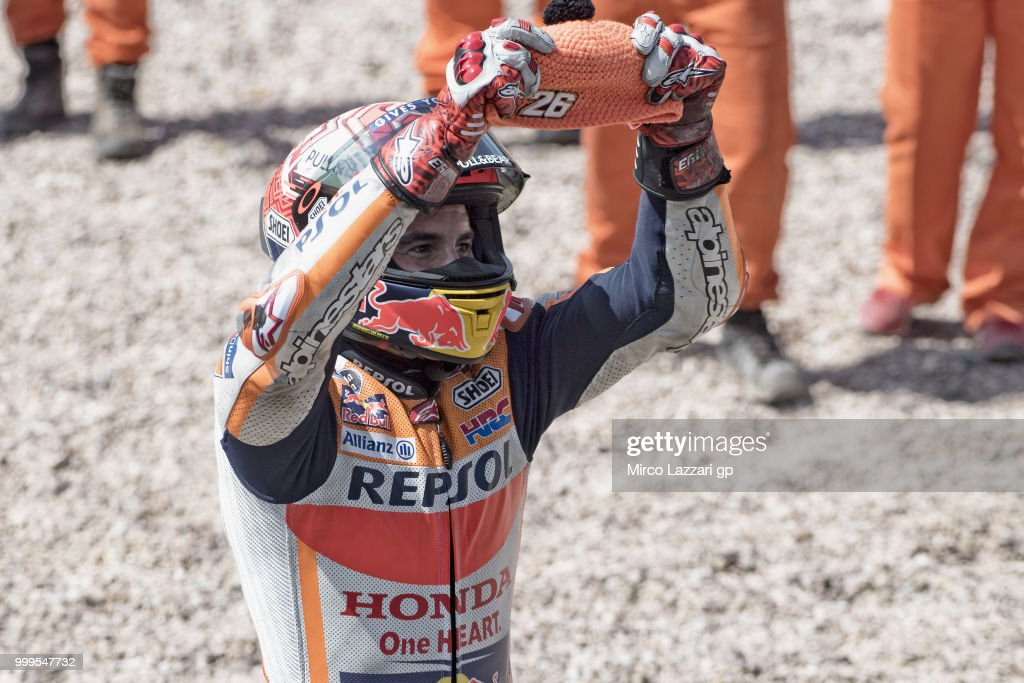 Marc Marquez of Spain and Repsol Honda Team celebrates Dani Pedrosa of Spain with his cap at the end of the MotoGP race during the MotoGp of Germany - Race at Sachsenring Circuit on July 15, 2018 in Hohenstein-Ernstthal, Germany.